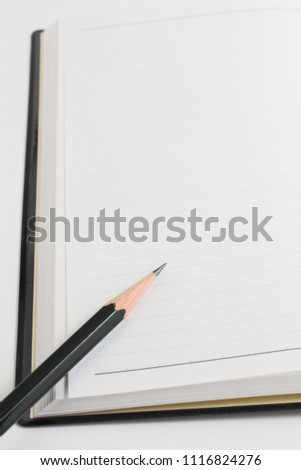 Schedule book and pencil #1116824276