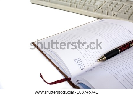 schedule with pen and keyboard isolated