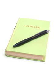 Schiller book with pen isolated on white background