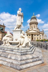 Schiller monument and French Church dome on Gendarmenmarkt square, Berlin, Germany