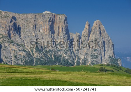 Schlern/Sciliar ridge with Santner & Euringer tower peaks on northwest side, unique profile & distinguishable landmark seen from Alpe di Siusi/Seiser Alm high plateau, Dolomites, South Tyrol, Italy