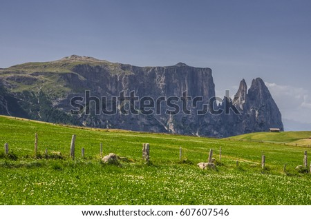 Schlern/Sciliar ridge with Santner & Euringer tower peaks on northwest side, unique profile & distinguishable landmark seen from hotel Panorama on Alpe di Siusi plateau, Dolomites, South Tyrol, Italy