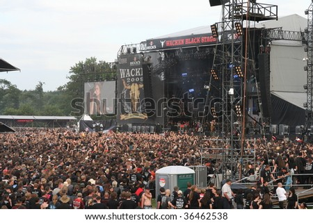 SCHLESWIG-HOLSTEIN, GERMANY - AUGUST 1: Large crowd of people at Wacken Open Air, world's largest open air heavy metal music festival on August 1st, 2009, in Schleswig-Holstein, Germany