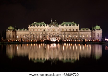 Schloss Belvedere at night with Christmas Market in Vienna, Austria.