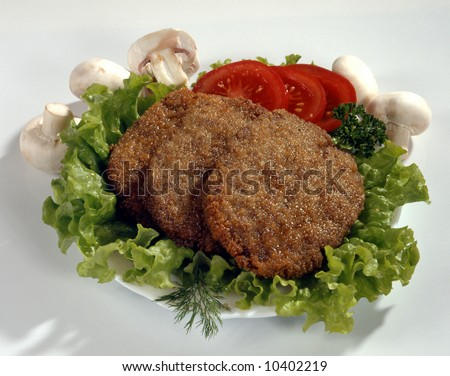 Schnitzel in a plate with vegetables