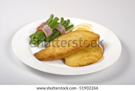 Schnitzel with beans - stock photo