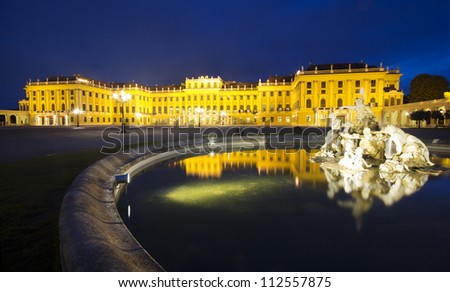 Schonbrunn Palace in Vienna, Austria - frontal view with the fountains, at night.