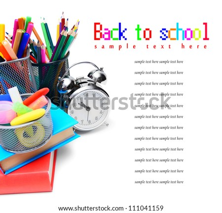 School accessories, books and alarm clock. On a white background.