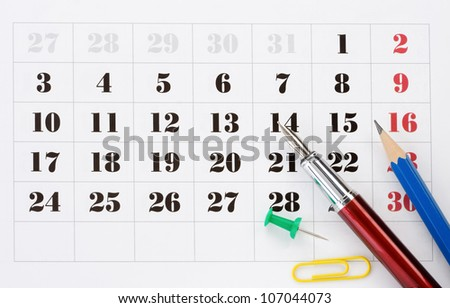 school accessories  on calendar background - stock photo