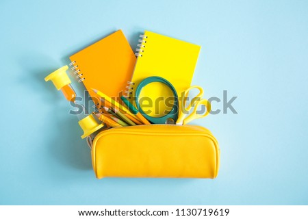 School accessories on soft blue background. Back to school concept. Creativity for kids. Colorful school background. Flat lay, top view, copy space