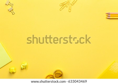 School accessories on yellow background. Minimal style. Flat lay. Copy space. Top view