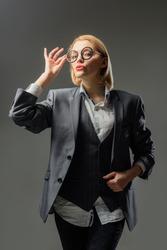 School advertising.Sensual female teacher. Silhouette of female teacher in glasses. Education concept. School. Portrait of female teacher in suit. Business concept.