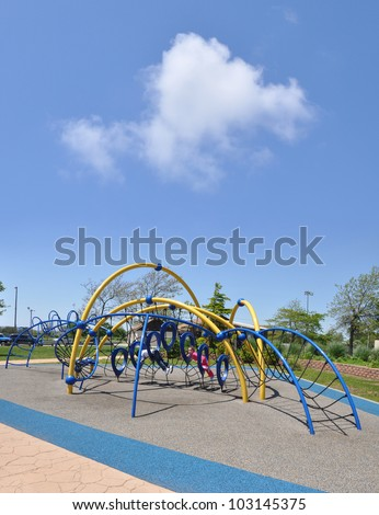 School Age Children Playing on Outdoor Playground Equipment in Suburban Residential Neighborhood