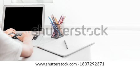 school at home through online homeschooling. the child is sitting at the computer