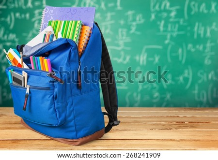 School. Backpack with school supplies including, notebooks, pens, pencils, rulers and glue