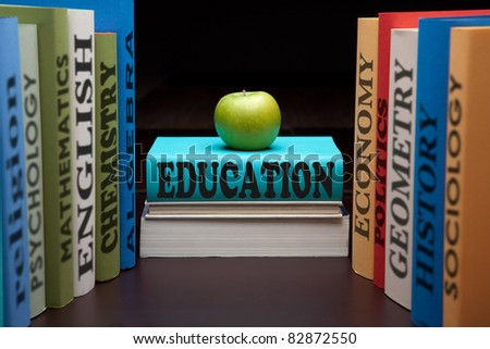 School books on a stack educational textbooks with text and apple education leads to knowledge wisdom in the study book for university or college.