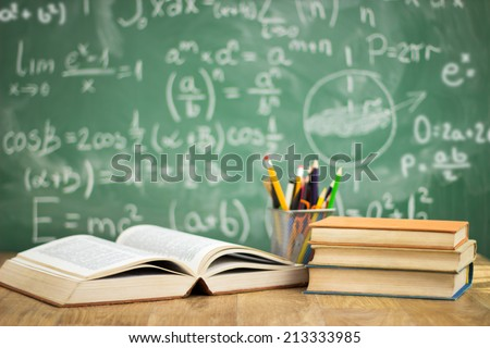 School books on desk, education concept