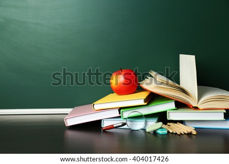 school books on desk near...