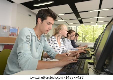 School boy in computing class using computer