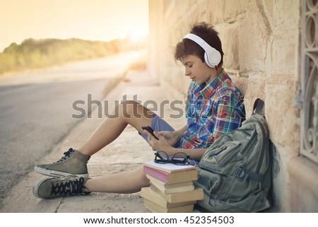 school boy listening to music