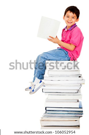 School boy reading a book and smiling - isolated over a white background