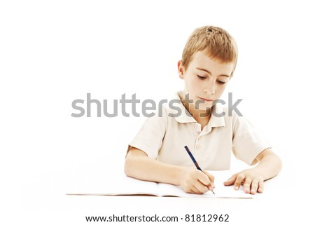 School boy sitting and writing in notebook. Isolated on white background