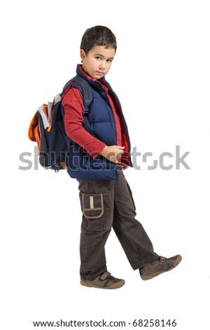 school boy standing with his backpack