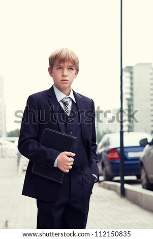 School boy with electronic tablet, outdoor