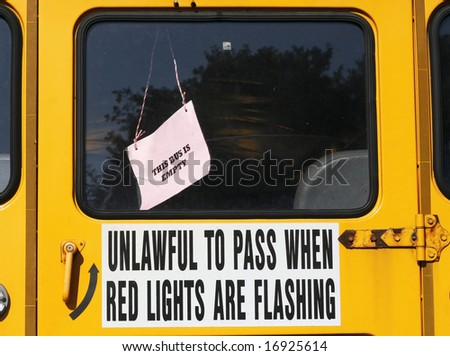 "school bus back door with sign ""this bus is empty"" - stock photo"