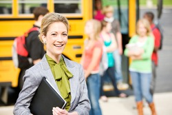 School Bus: Cheerful School Principal With Students In Background