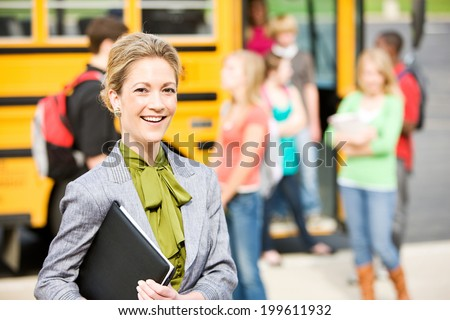 School Bus: Cheerful School Principal With Students In Background Foto d'archivio ©