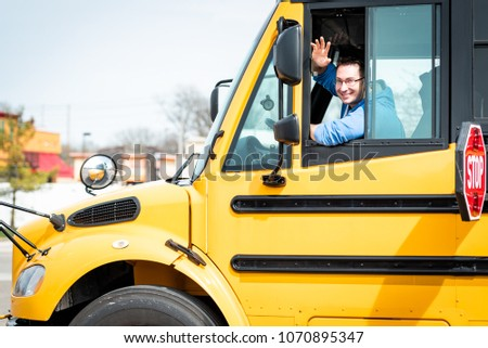 School bus driver waving out window #1070895347