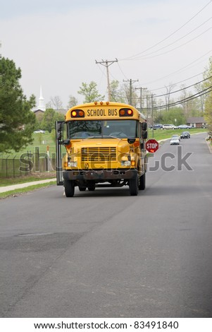 School bus dropping of children after school, traffic staying well back
