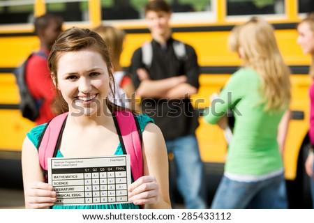 School Bus: Girl Student Has Great Report Card