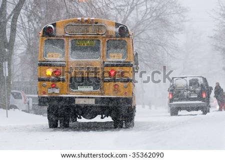 school bus in a snowstorm