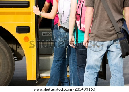 School Bus: Line of Students Leaving School