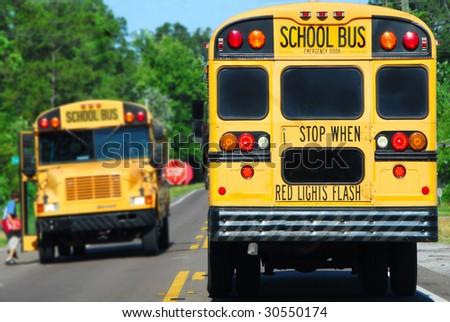 school bus on rural road picking up children