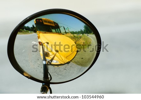 School bus reflected in its own wide angle safety mirror