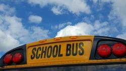 School Bus sign against blue cloudy sky