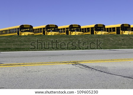 School buses waiting in front of the school