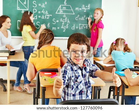 School child with teacher in classroom