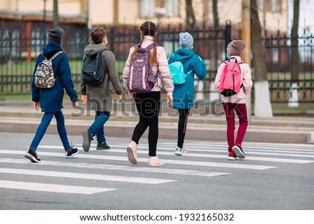 School children cross the road in medical masks. Children go to school Photo stock ©
