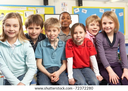 School Children In Classroom Smiling