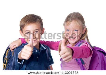 School children with backpacks showing thumbs up. Isolated on white.