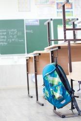 School classroom with school desks and blackboard