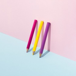 School color pencils on pastel background. Minimal concept art.