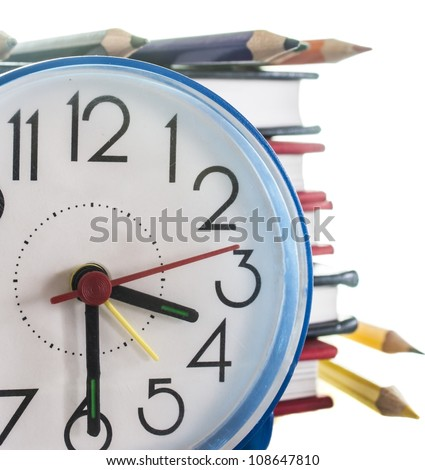 school composition,pencils, books and clock, isolated on white