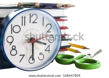 school composition,pencils, books,scissors and clock, isolated on white