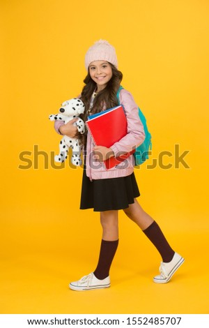 School creating textbooks generation. Active role in curriculum. Schoolgirl with textbooks. Innovating existing platforms. Future textbooks modern education. Textbook useful in learning environment.