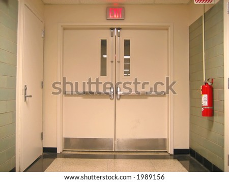 School Emergency Exit with Exit Sign and Fire Extinguisher.